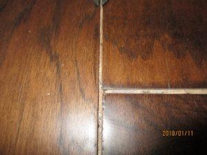wide gaps between flooring planks